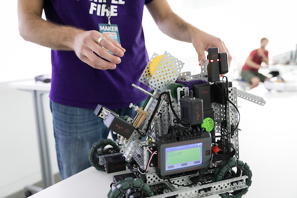 student works on robot