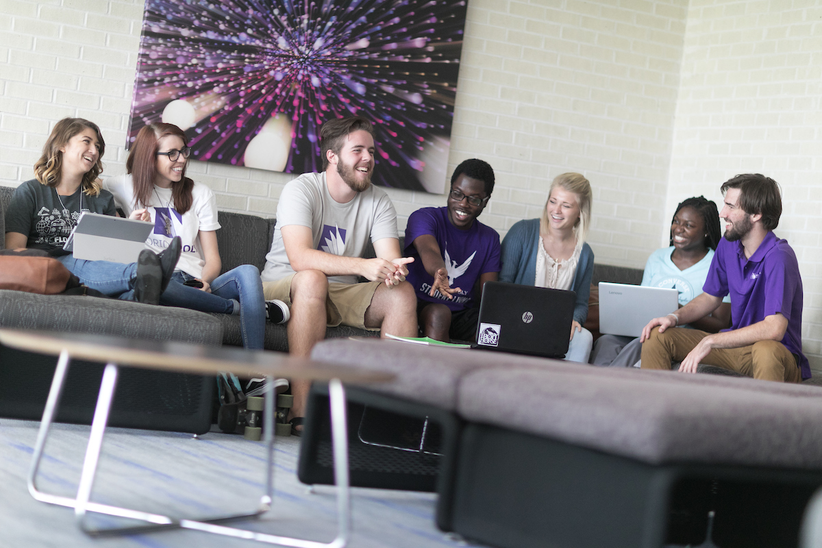 Students sitting in common area of residence hall.