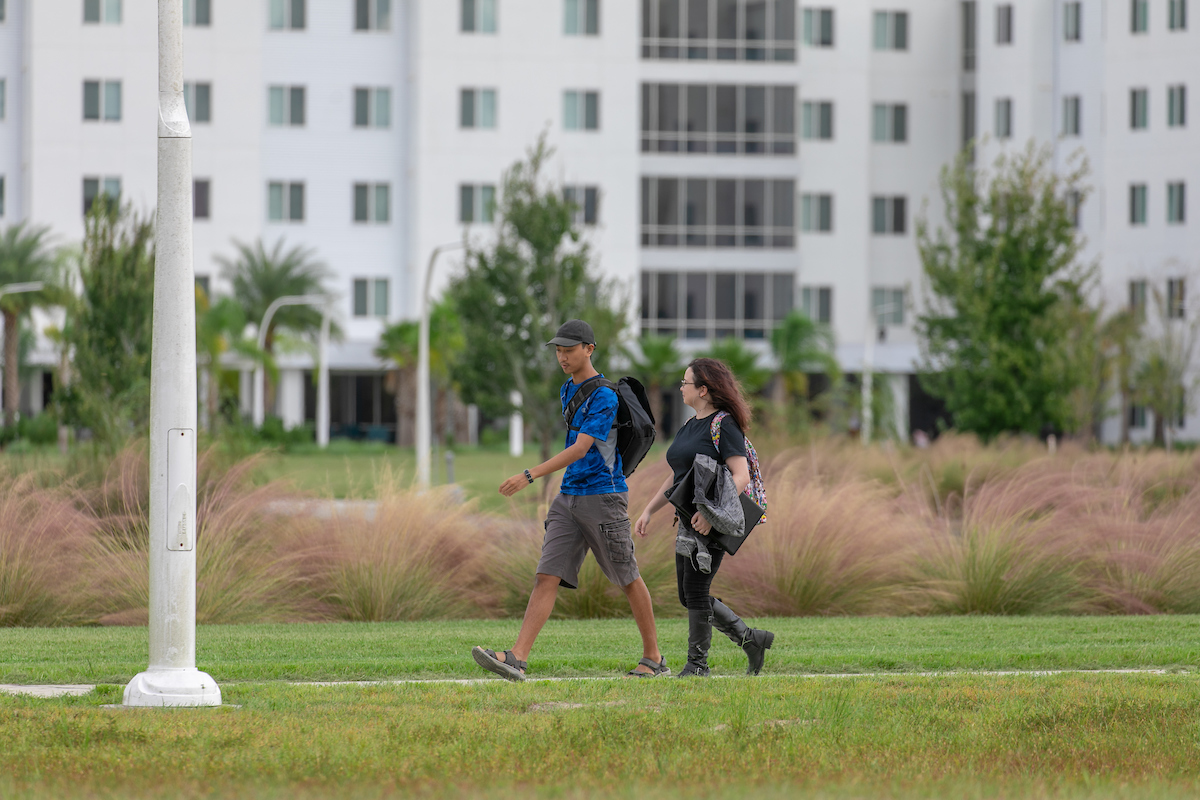 students walking in front of residence halls