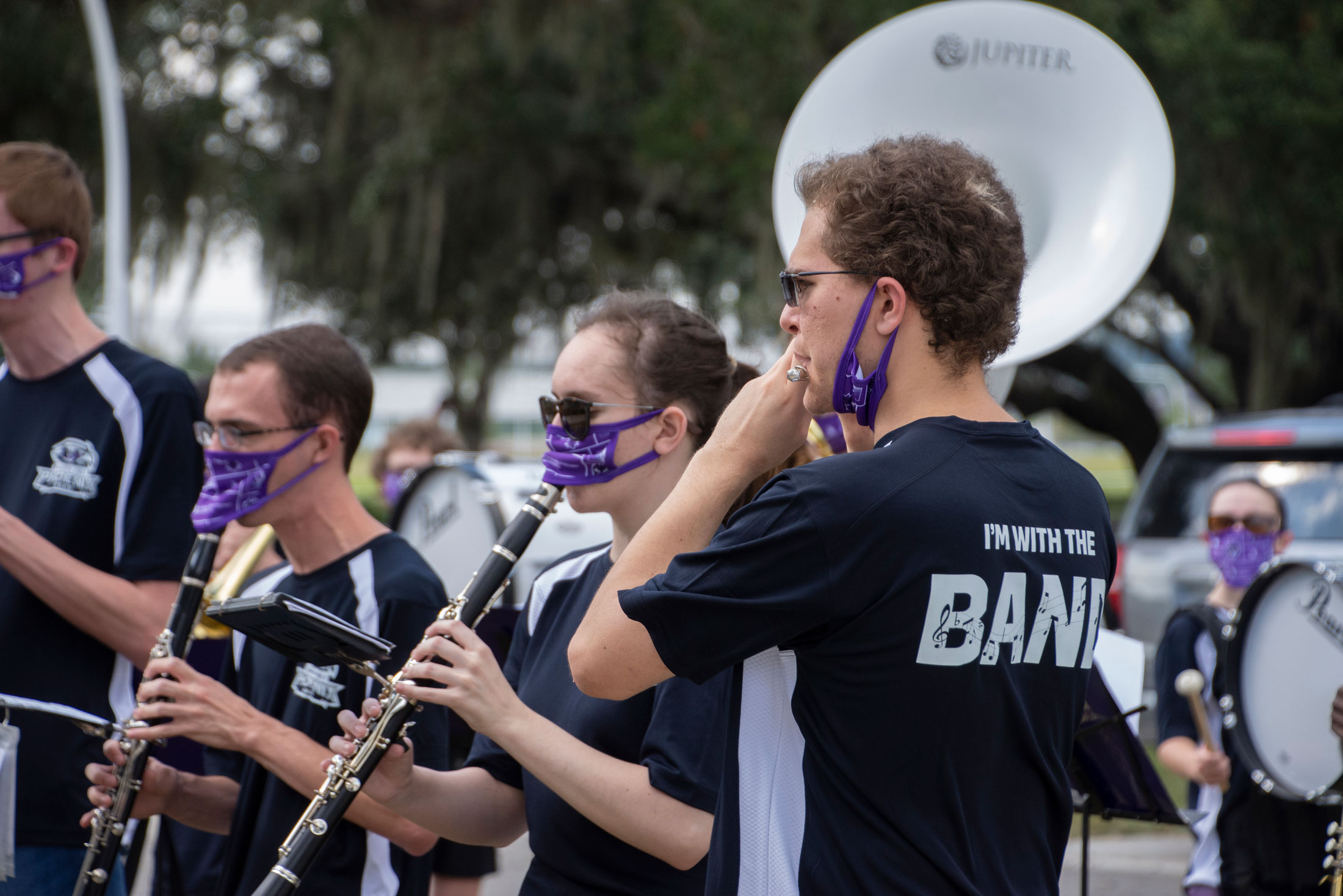 Florida Poly male student playing in a band.
