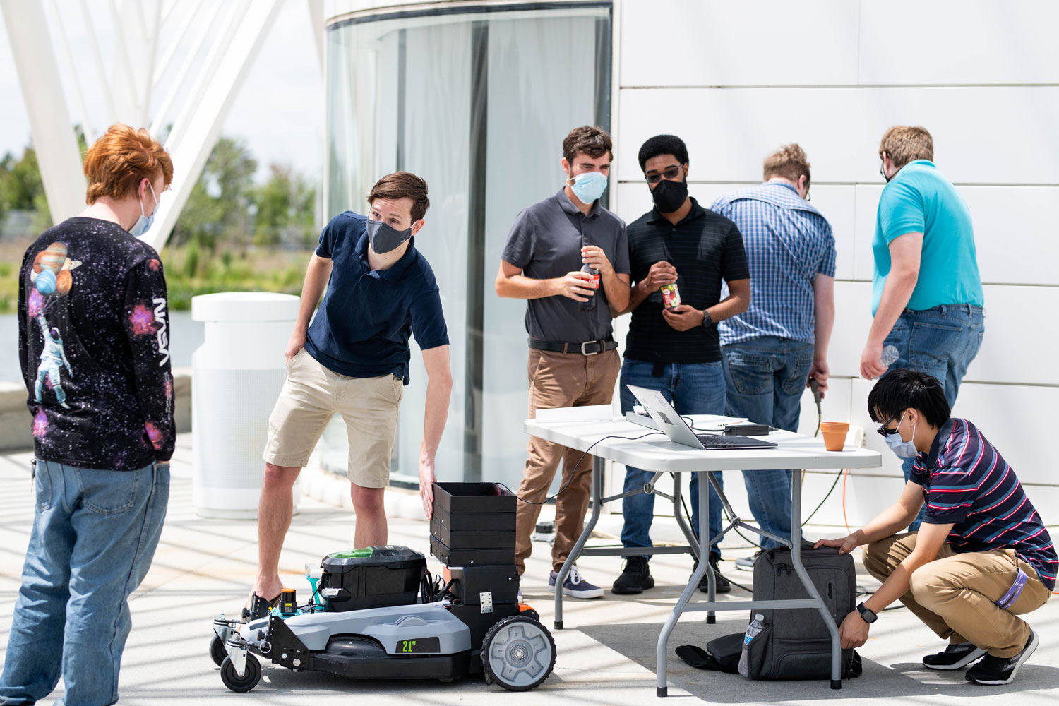 students demonstrate robotic mower
