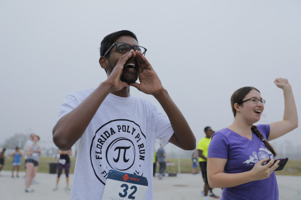 Florida Poly students cheering on other racers at the 5th Annual Pi Run.