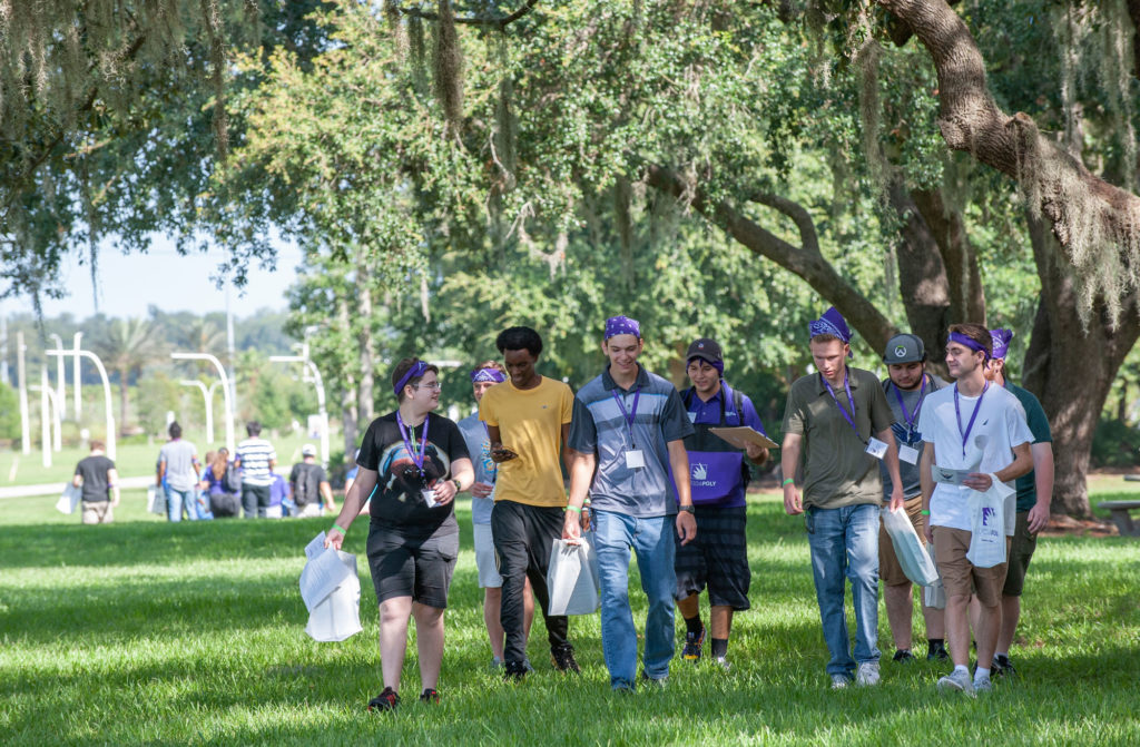 Incoming freshmen walk across the Florida Polytechnic University campus during pre-orientation in July 2019.