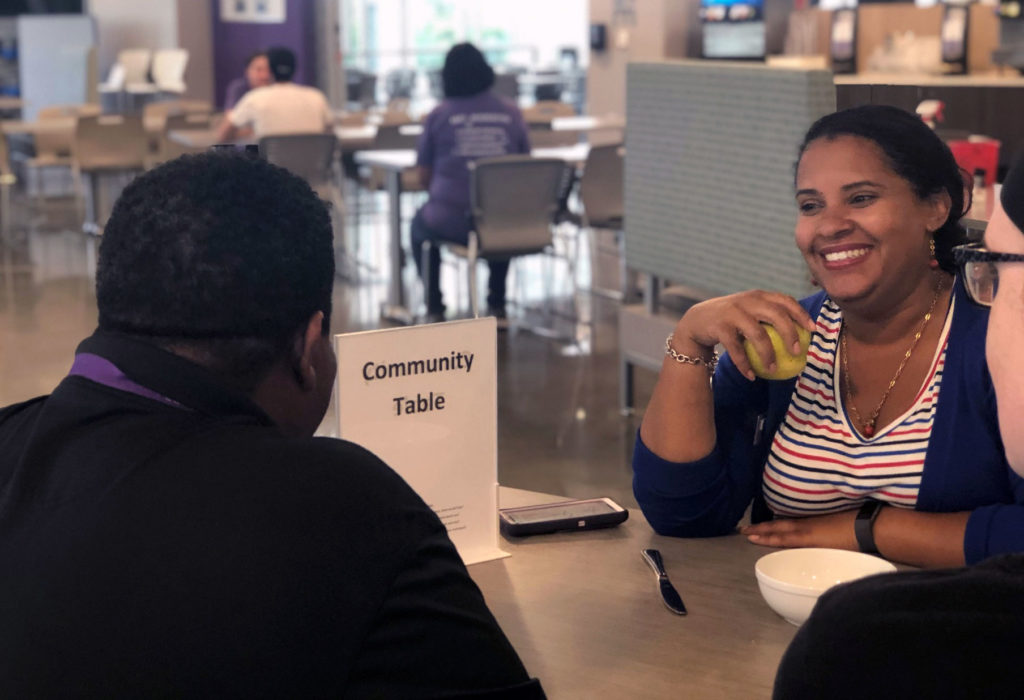 Academic success coach Carolina Barrios created the community table to foster engagement within the Florida Polytechnic University community. The table inside the Wellness Center dining hall allows students to show they are open to having a conversation.