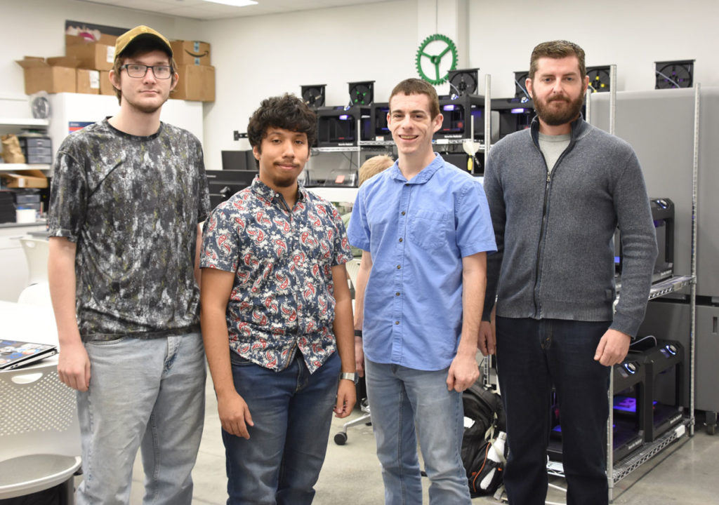 Four students in 3D printing lab at Florida Polytechnic University