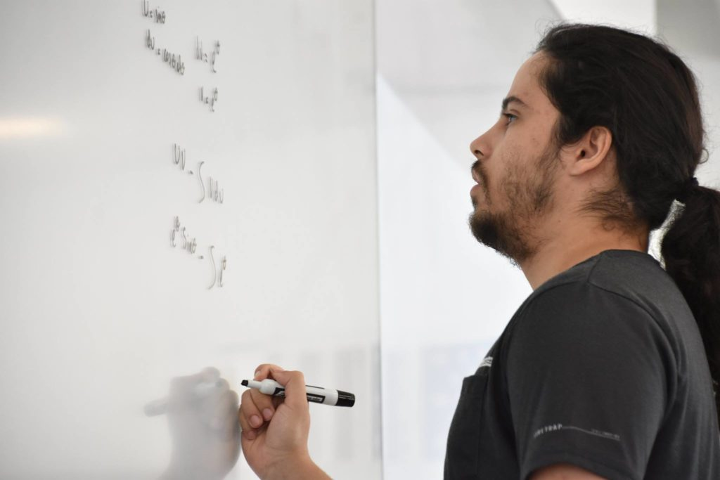 Florida Poly male student competing at the 2019 integral bee.