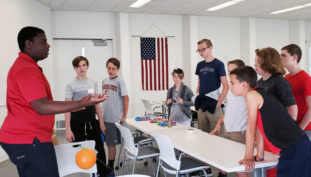 Florida Poly student teaching at summer camp.