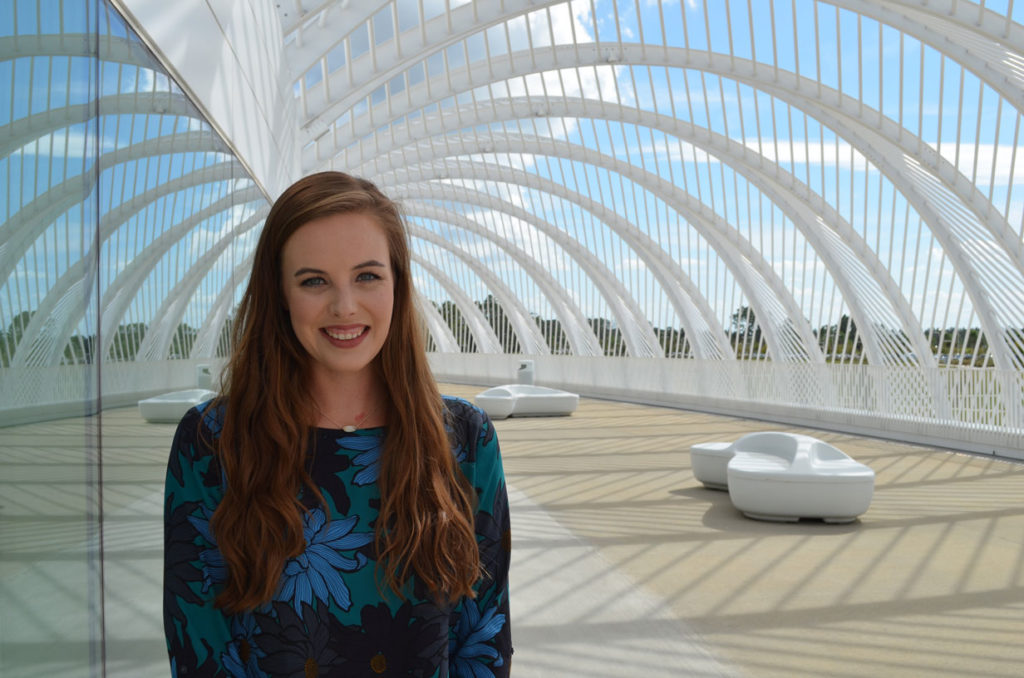 Florida Poly's assistant professor of mathematics Abigail Bowers in front of Innovation Science and Technology building.