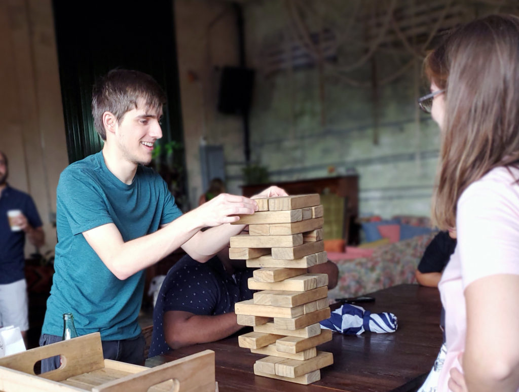 Florida Polytechnic University alumni playing Jenga during an alumni event at the Poor Porker in downtown Lakeland, Florida on July 20.