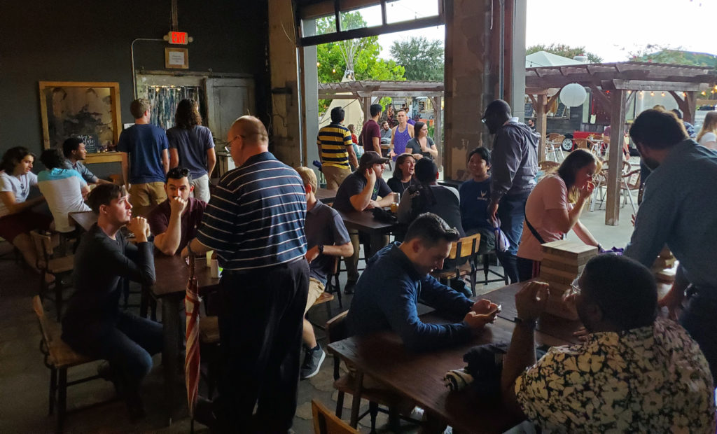 Florida Polytechnic University alumni hangout during an alumni event at the Poor Porker in downtown Lakeland, Florida on July 20.