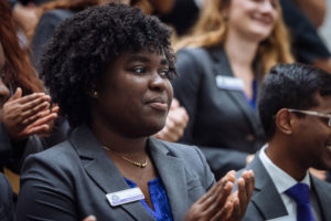 Florida Poly student clapping at Presidential Ambassador Ceremony