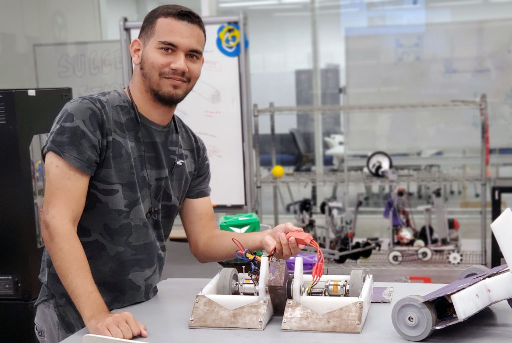 Purple Fire Robotics club member Bryan Garcia shows a combat robot the club has built. He is leading the design of a 250-pound combat robot the team hopes will secure a spot on the BattleBots television show.