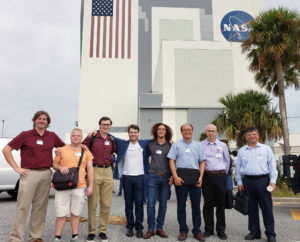 Group of students and faculty outside of NASA space center building.