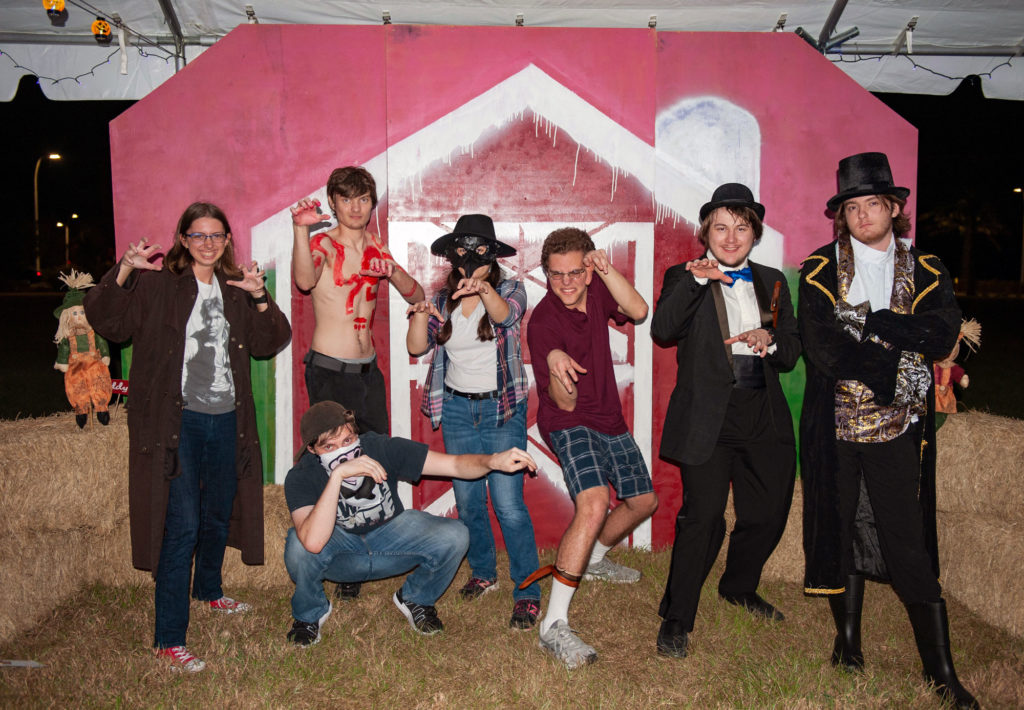 Group of seven students dressed up on Halloween.