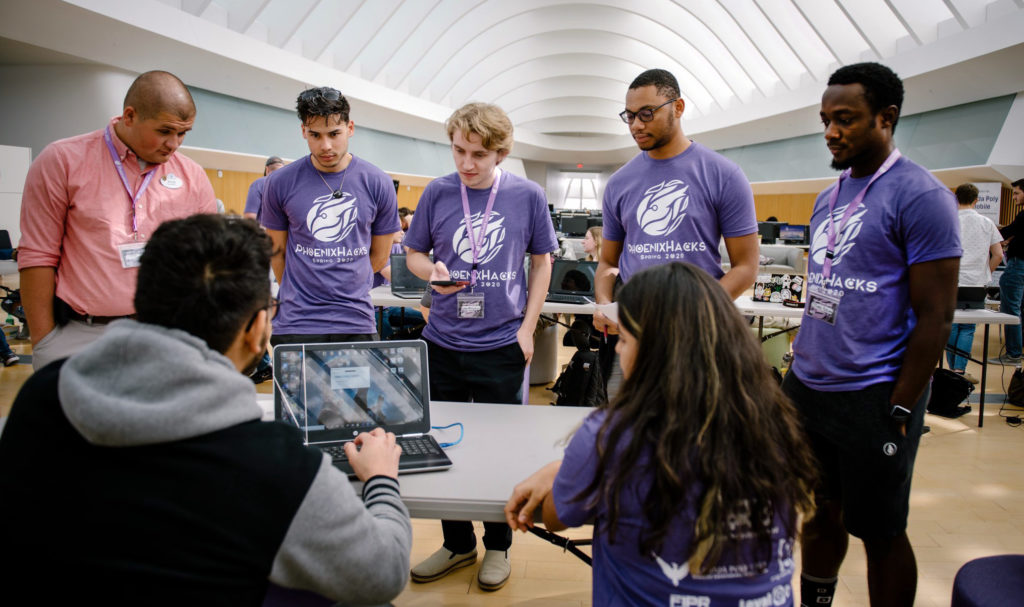 Judges learn about one of the student-created projects during PhoenixHacks, a hackathon that challenged Florida Polytechnic University students to create a software or hardware project in 24 hours.
