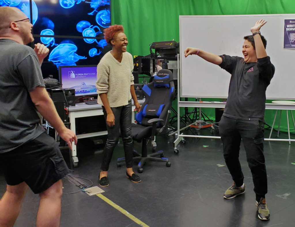 Florida Polytechnic University students Andrew Crosswait, left, Taryn Jones, and Ezekiel Huynh warm up during a recent meeting of student improv group The Baked Bean Bois.
