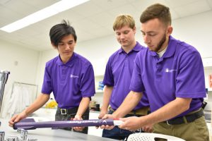 Eric Chan (left), Patrick Mahoney (center) and Brent Collins are part of a six-member Florida Poly team called the Phoenix Flyers, which will compete in a statewide rocket launch competition sponsored by NASA's Florida Space Grant Consortium.