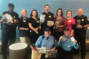 Florida Poly Police department sharing gifts to children at Lakeland Regional Health Medical Center.