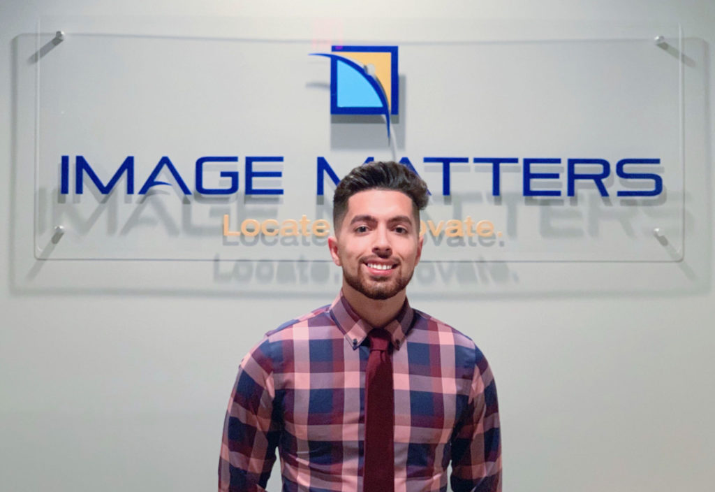 Light skinned male in front of Image Matters sign.