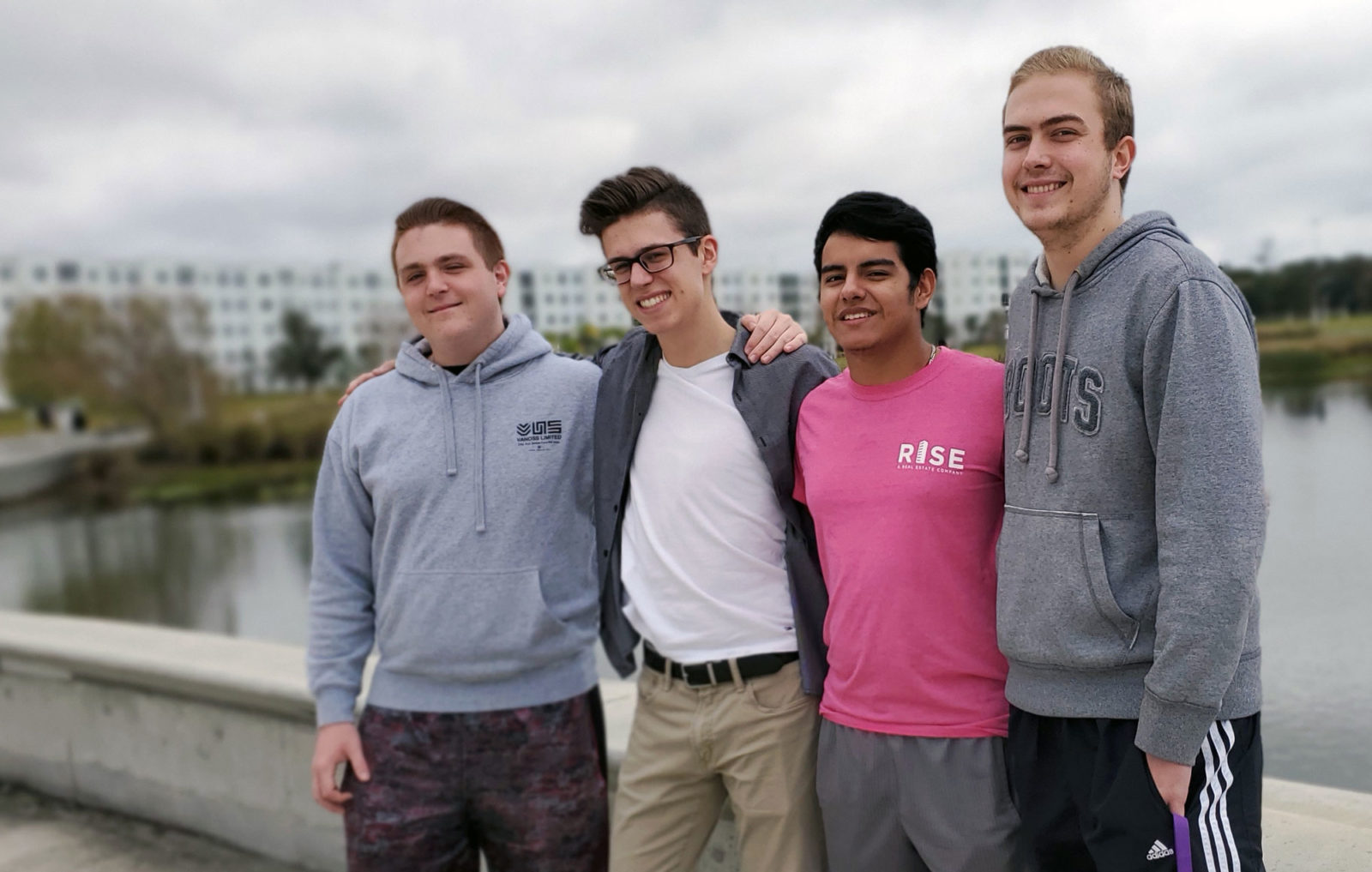 Four male students standing outside.